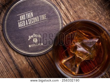 London, Uk - September 04, 2018: Glass Of Jim Beam Bourbon Whiskey With Original Coaster On Wooden B