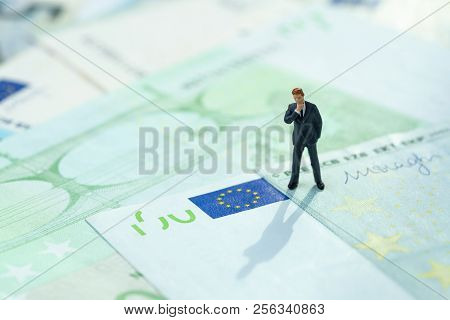 Europe Economy, Financial, Investment Or Impact Of Brexit Concept, Miniature Businessman Figurine St