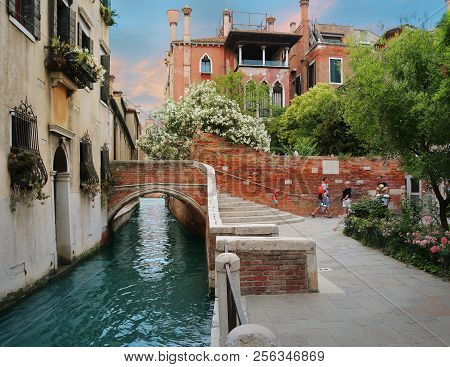 Venice, Italy, Jun 7, 2018: View Of An Inner Canal And  Bridge With Locals Walking By In Venice, Ita