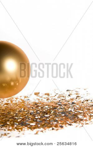 Gold Christmas ball isolated on white background with glass splinters