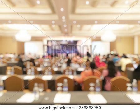 Blurred Image Abstract Background Of People In Modern International Conference Room, Meeting Room Or