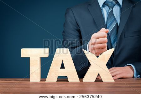 Tax Reduction Business And Financial Concept. Angry Businessman Try To Destroy Text Tax.