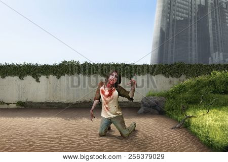 Spooky Zombie Man Crawling On Abandoned City. Halloween Concept
