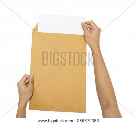 Hands Insert The Paper Into Brown Envelope Isolated Over White Background