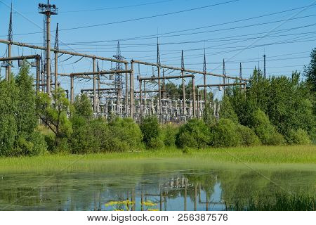 Power Station Near The Pond. Power Lines.