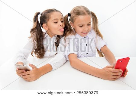 Having Fun. Happy Little Children Girls Having Fun At School With Mobile Phone. Digital Age Students