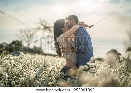 Romantic Couple Exploring a field of flowers