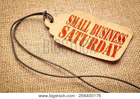 Small Business Saturday sign - a paper price tag with a twine iagainst burlap canvas poster