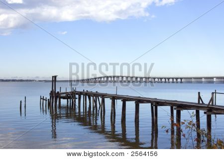 Old Fishing Pier And New Bridge