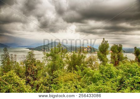 Lake Landscape Under Cloudy Grey Sky, Horizontal Image