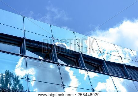 Mirrored Facade With Clouds. Moredn Architecture Shot