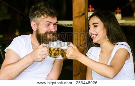 Couple In Love On Date Drinks Beer. Best Friends Or Lover Drinking In Pub. Man Bearded Hipster And G
