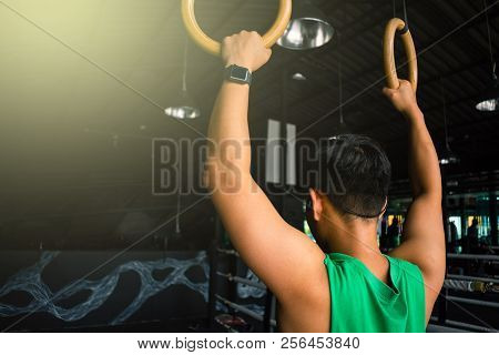 Asian Man Athlete Gymnast Rings Exercise In Gymnastics Exercise Chest  Workout On Bench Press Cable