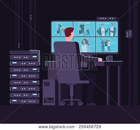 Surveillance Monitoring Room. Man Watching Surveillance Camera On Monitor In Dark Control Room. Secu