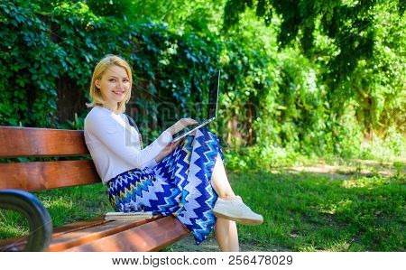 Free Time Surfing Internet In Park. Girl Sit Bench With Notebook. Surfing Net In Nature. Woman With