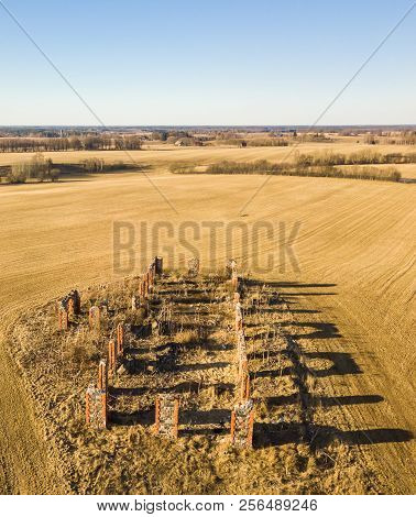 Drone Photo Of The Ruins Of An Old House In Countryside Fields