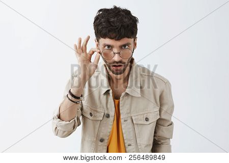 Are You Serious. Surprised And Doubtful Good-looking Male Model With Beard And Stylish Haircut Looki