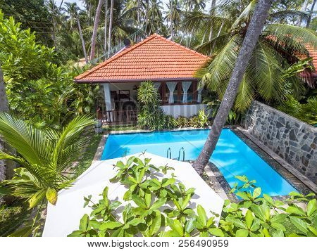 Tangalle, Sri Lanka - November 1, 2017: Pool With Blue Clean Water In Tropical Hotel. Beautiful Idyl