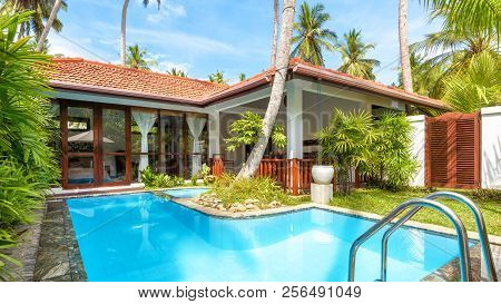 Sri Lanka - November 4, 2017: Panoramic View Of Luxury Tropical Hotel With Pool. Sunny Villa To Rela