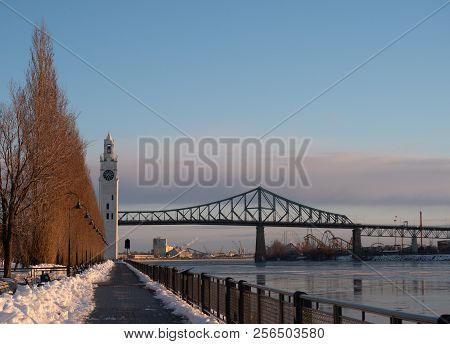 Montreal's Clock Tower And Jacques Cartier Bridge In The Winter