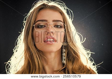 Optics Store Concept. Beauty Fashion Girl With Makeup And Big Earrings Jewelry, Dark Studio Backgrou