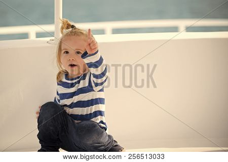 Small Adorable Kid Sitting In Boat. Yachting And Sailing. Childhood And Baby Care Concept. Little Bo