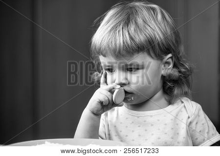 Closeup Portrait View Of One Adorable Cute Small Baby Boy With Blonde Hair Eating Healthy Food Of Po