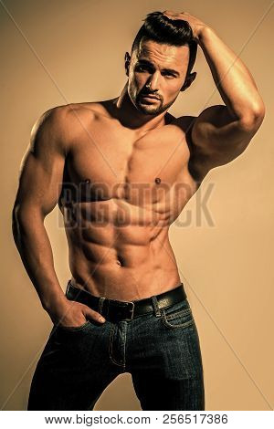Dieting And Fitness. Sport And Workout. Coach Sportsman With Bare Chest In Jeans. Athletic Bodybuild