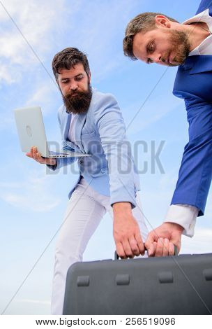 Businessman Pick Up Briefcase With Partner Holds Laptop. Pick Up Every Opportunity. Partners Entrepr