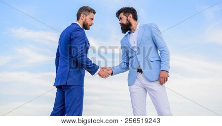 Men Formal Suits Shaking Hands Blue Sky Background. Business Deal Approved Accepted By Both Partners