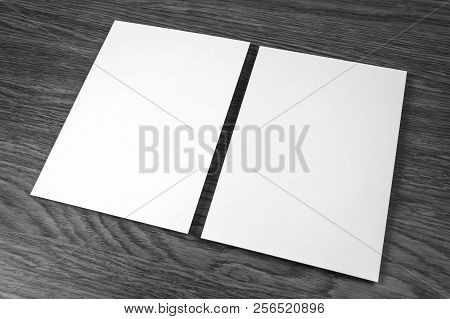 Blank Flyer Poster On Wooden Background To Replace Your Design