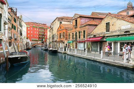 Venice, Italy, Jun 7, 2018: A Canal Street In Venice, Italy With Colorful Boats And Buildings With L