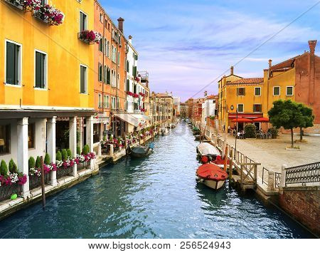 Venice, Italy, Jun 7, 2018: A Canal Street In Venice, Italy With Colorful Buildings With Trattoria (