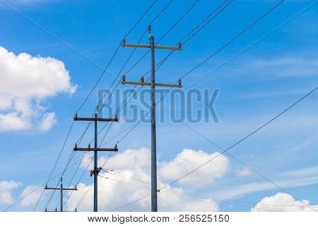 Multi-purpose Utility Poles With Blue Sky And Clouds In The Background