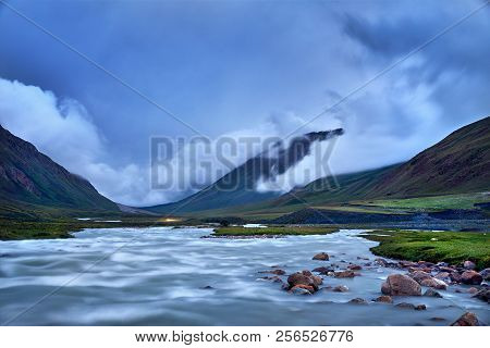 White Water River In The Mountain Valley At Foggy Cloudy Sky At Twilight In Kyrgyzstan