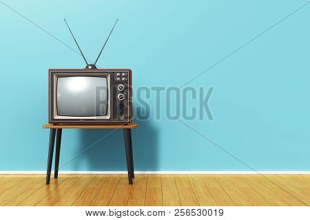 3d Render Illustration Of The Old Retro Tv Television Set With Antenna On Table Against Blue Vintage