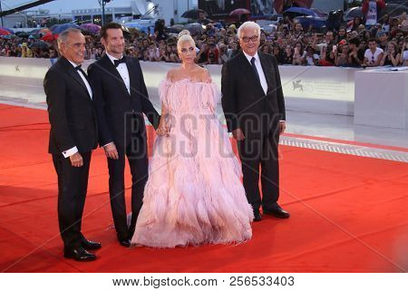 Lady Gaga, Alberto Barbera, Paolo Baratta,  Bradley Cooper walk the red carpet ahead of the 'A Star Is Born' screening during the 75th Festival at Sala Grande on August 31, 2018 in Venice, Italy.