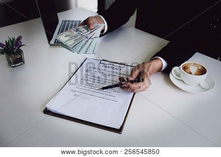 Loan Agreement, Borrow Money, Corruption Concept, Male Holding Pen Pointing Contract Application And