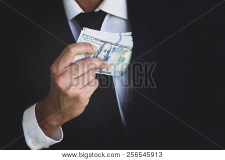 Male Keeping Money To His Shirt. Getting A Bribe, Giving Bribes, Illegal Concept