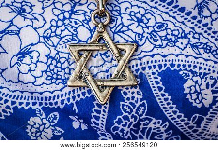 A Star Of David, Famous Jewish Hexagram Symbol, On A  Flower Background.