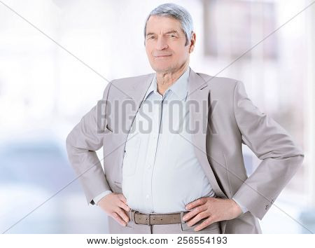 In Full Growth. Confident Senior Businessman Isolated On White