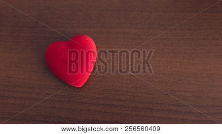Red Heart On A Wooden Background, Concept Of Medicine Or Love