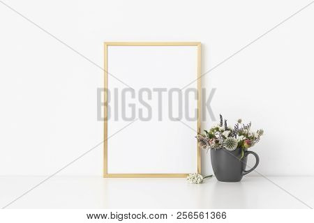 Gold A4 Portrait Frame Mockup With Small Bouquet Of Dried Flowers In Pot On White Wall Background. E