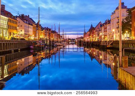 Panorama of Nyhavn with colorful facades of old houses and old ships in the Old Town of Copenhagen, capital of Denmark. poster