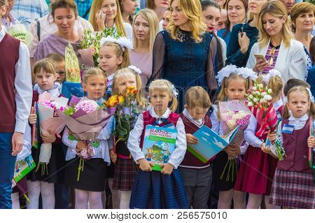 Minsk, Belarus - September 1, 2018 Solemnly Dressed First-graders With Donated Book On Their First D