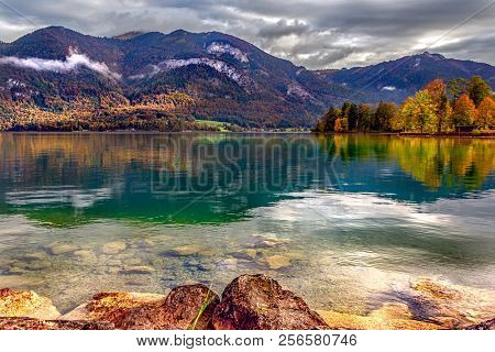 Wolfgangsee lake view, Sankt Gilgen, Austria. Picturesque landscape of Alpine lake and mountains