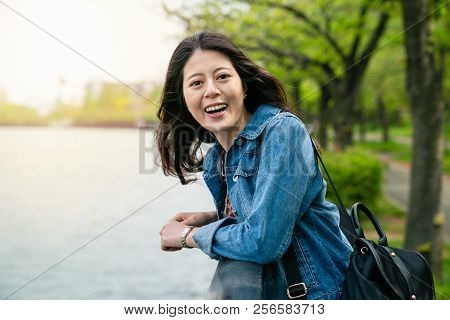 Asian Woman Laughing And Standing To River.