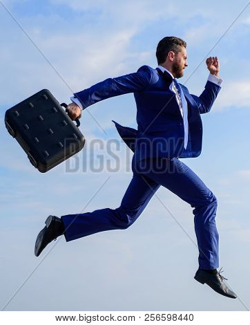 Success in business demands supernatural efforts from entrepreneur personality. Businessman with briefcase jump high motion forward. Businessman formal suit make effort to succeed. Supernatural power poster