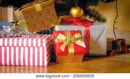 Stack Of Presents In Wrapped In Colorful Paper Lying Under Christmas Tree