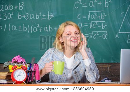 Pleasant relax after classes. Working conditions which prospective teachers must consider. Woman smiling teacher holds mug drink classroom chalkboard background. Working conditions for teachers poster